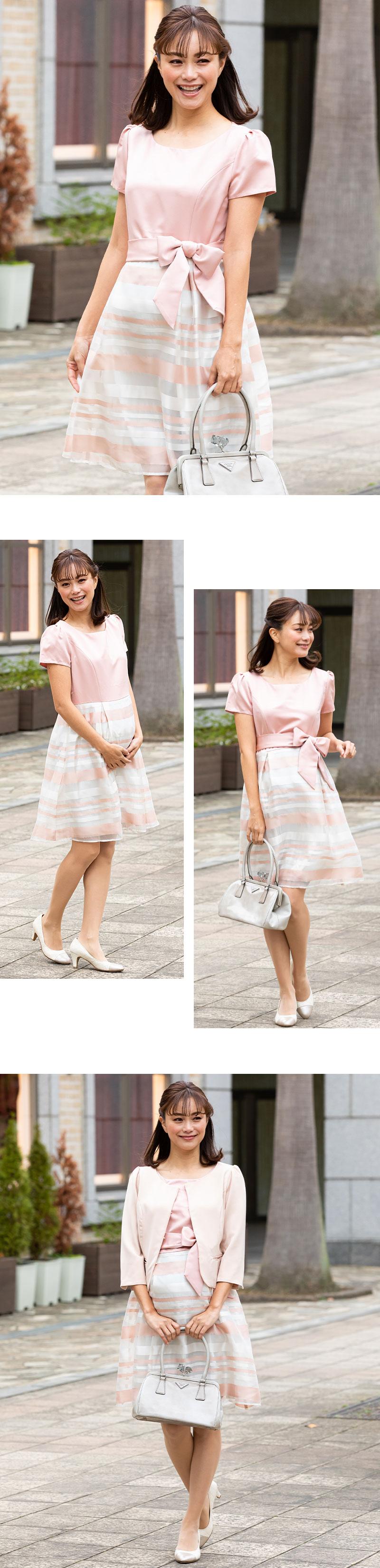 優しい印象のピンク着用